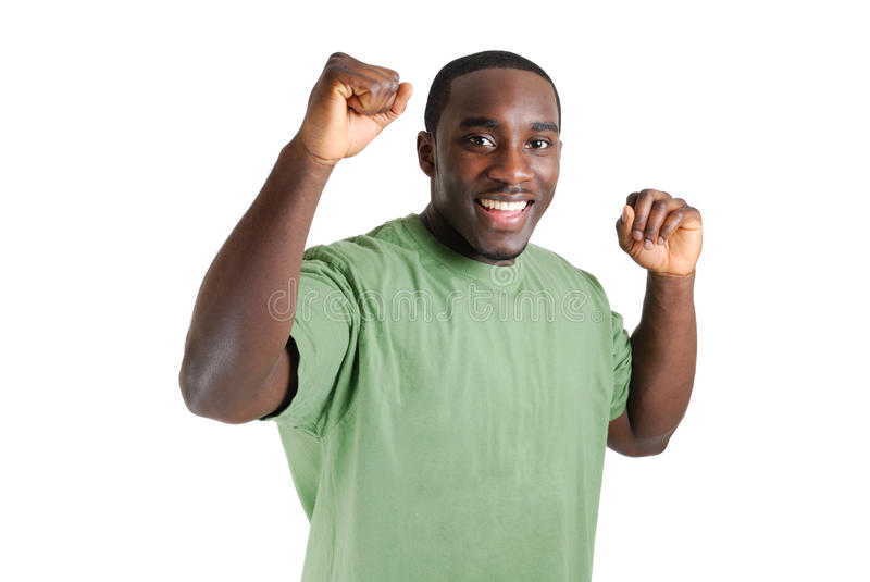 Young Student With His Arms Raised Celebrating Suc Royalty Free Stock Photography