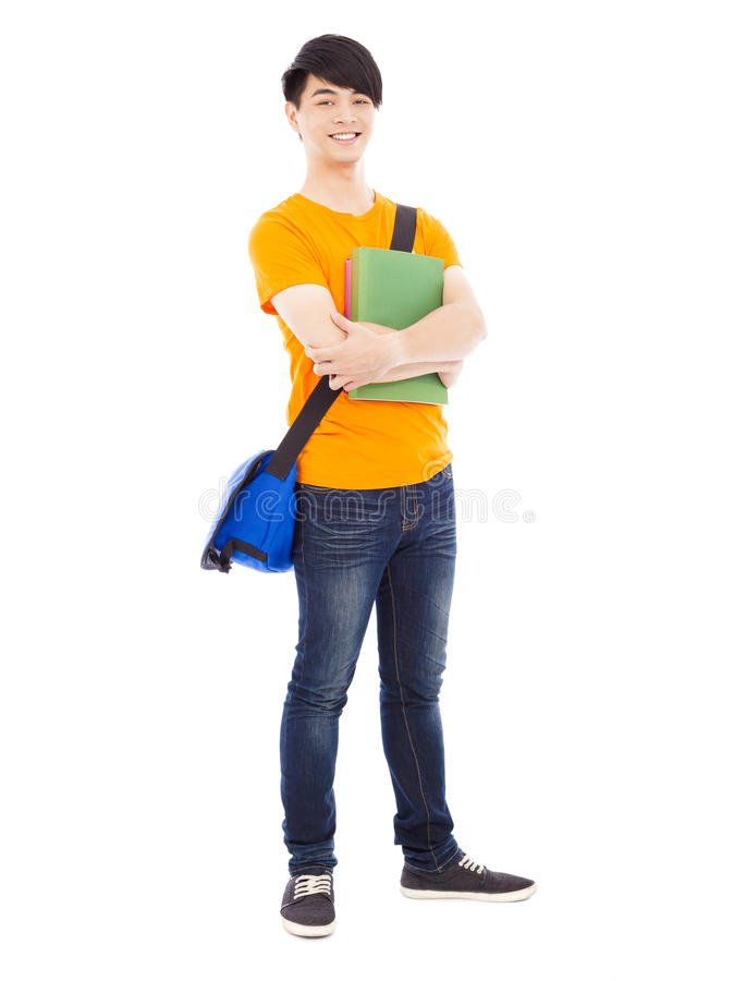 Young student holding books and slanting knapsack. Over white background royalty free stock photos