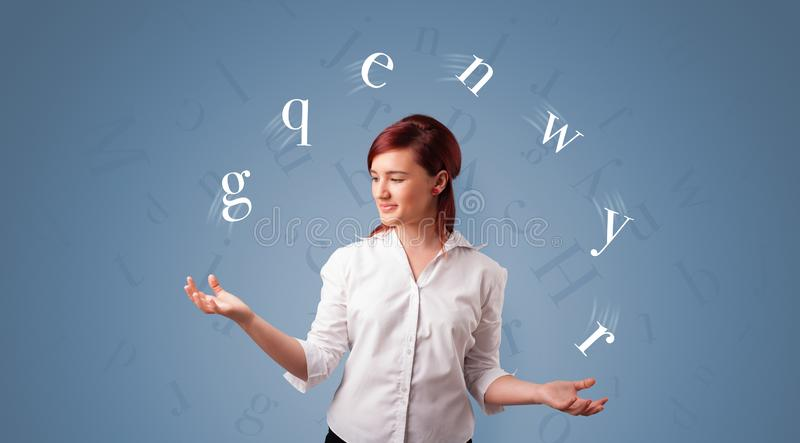 Person juggle with letters stock photo
