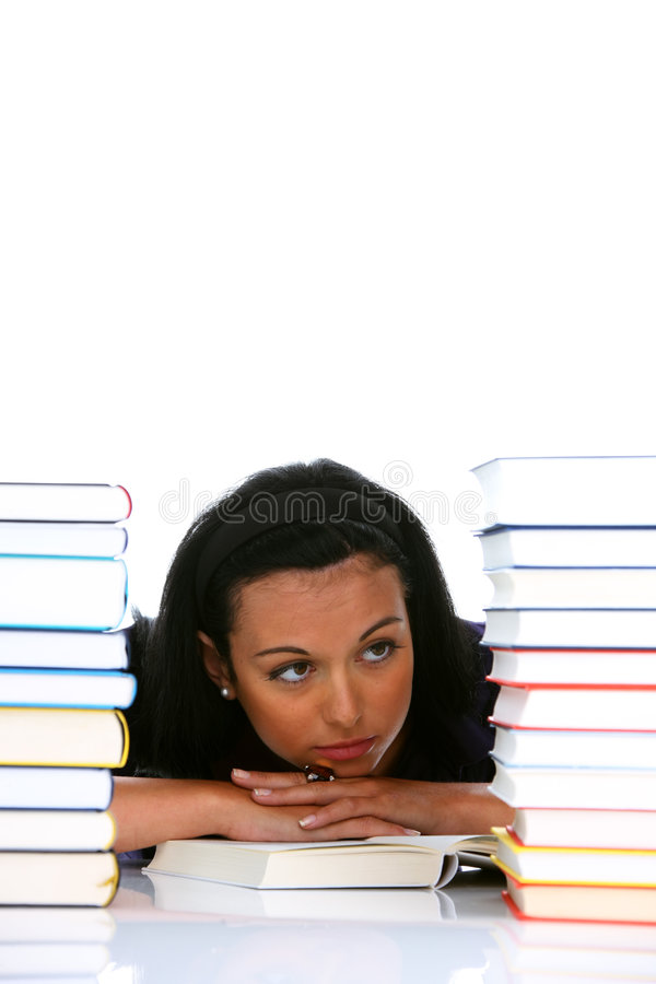 Young student learns a stack of books stock photo