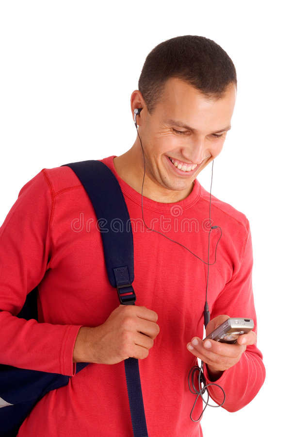 Young student listening music stock image