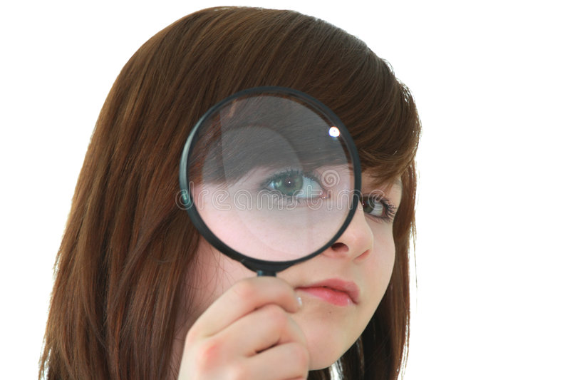 Young student with magnifier stock photography
