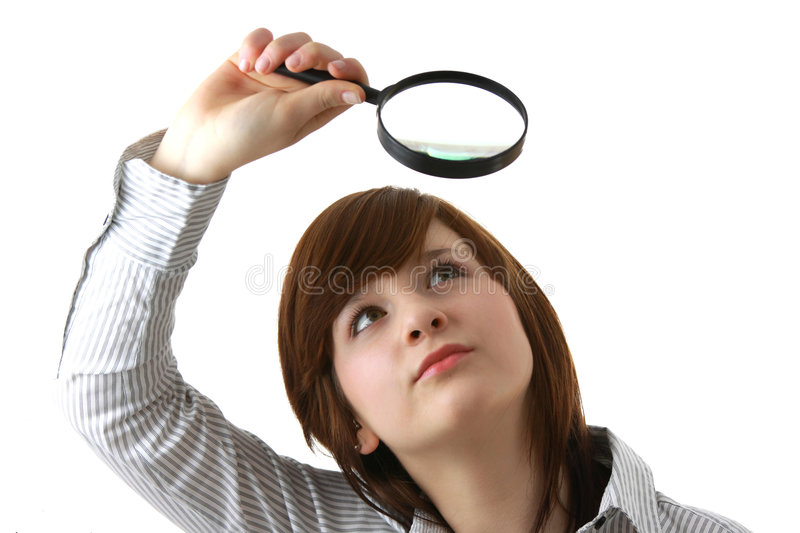 Young student with magnifier royalty free stock photo