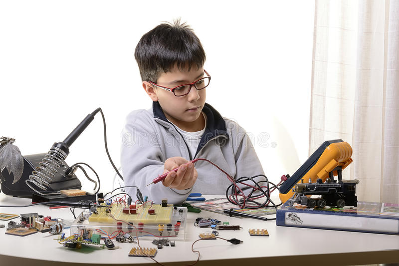 Young student performs experiments royalty free stock photography