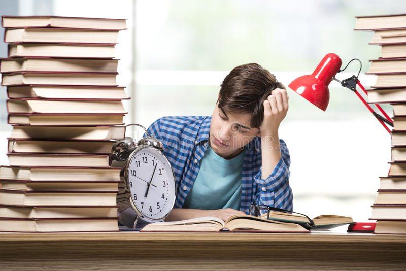 The young student preparing for school exams royalty free stock image
