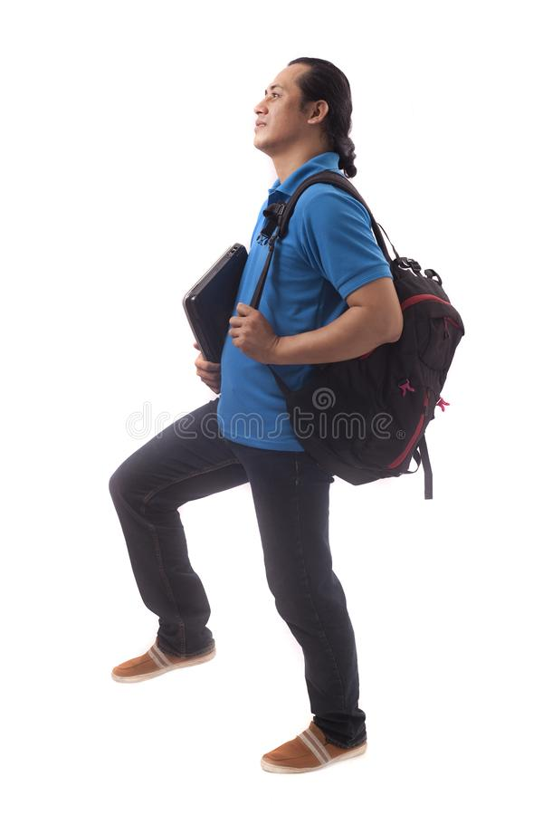 Young Student Stepping Forward Isolated on White stock images