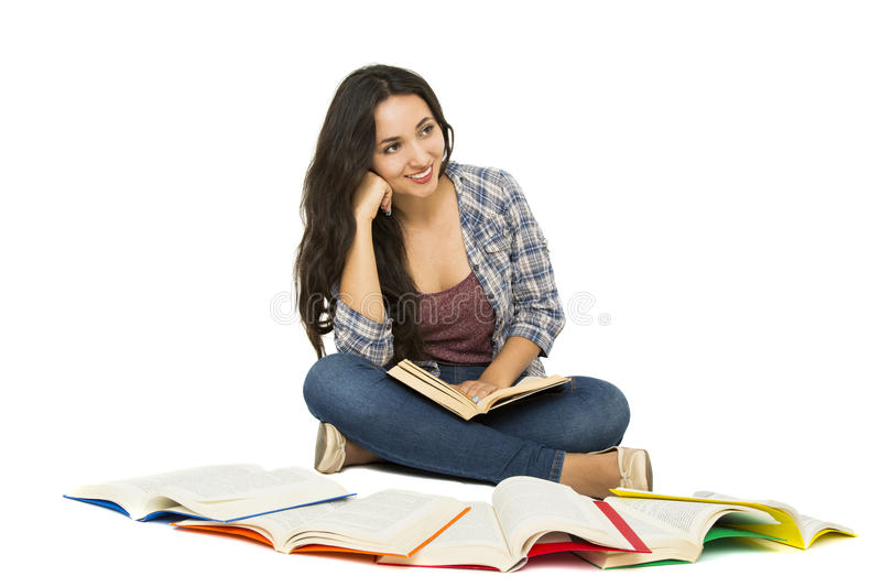 Young student. Surrounded by books royalty free stock photos