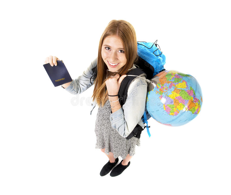 Young student tourist woman holding passport carrying backpack and world globe. In backpacker holidays trip and vacation tourism concept isolated on white royalty free stock image