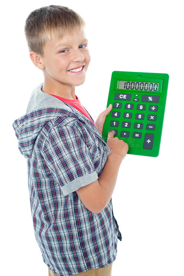 Young student using a large green calculator stock images