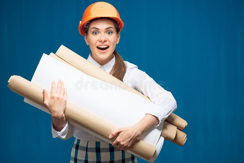 Young student woman architect holding paper plans, blueprints royalty free stock photos