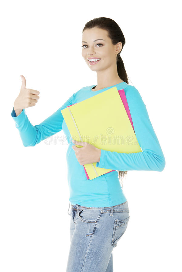 Young Student Woman Gesturing OK Royalty Free Stock Photo