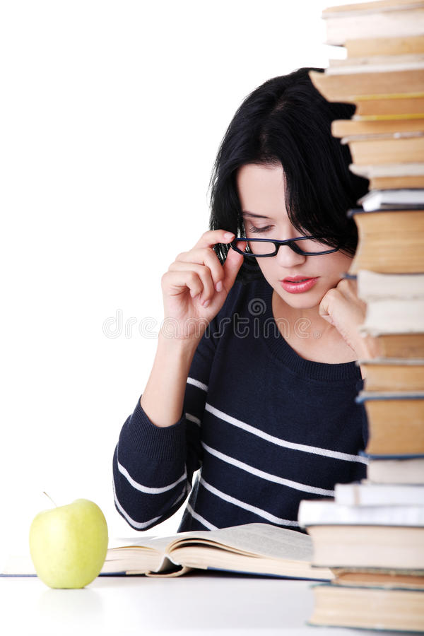 Young Student Woman Studying At The Desk Royalty Free Stock Images