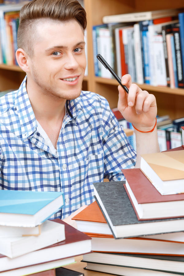 Young student working in a library stock photo