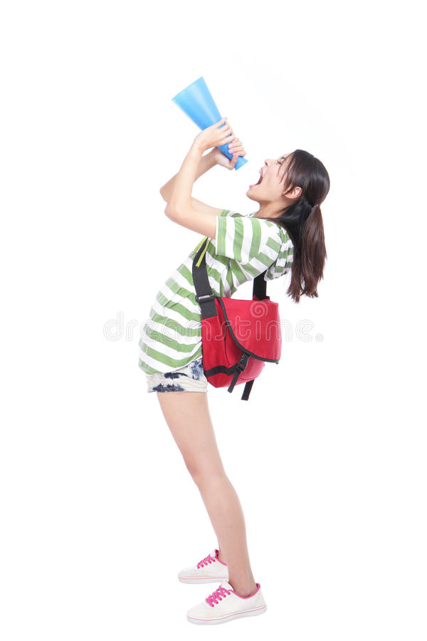 Young student yelling through megaphone. Young university student yelling through megaphone to empty copy space with full length isolated on white background stock photography