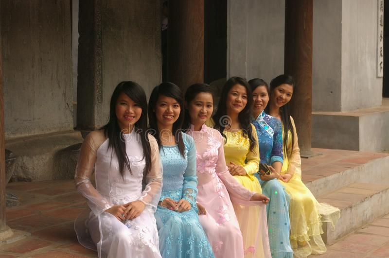 Young students in Ao Dai stock images