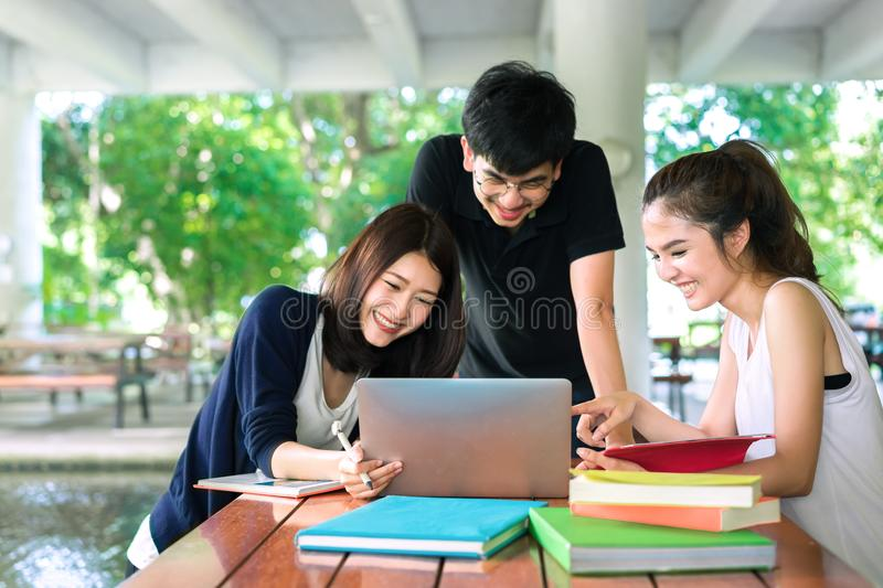 Young Students Group Consult with School Folders. Laptop Computer in Education Campus University stock photography