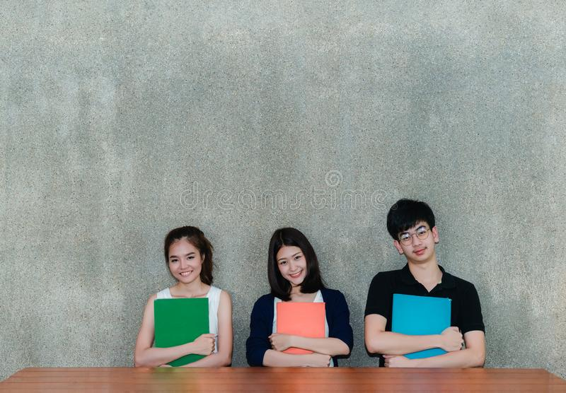 Young Students Group Smile Hugging School Folders Book stock photo