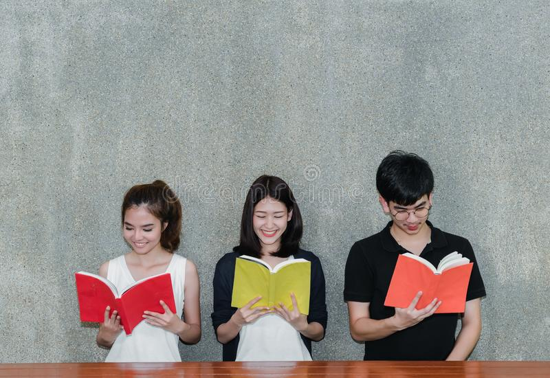 Young Students Group Smile Reading Book royalty free stock photos