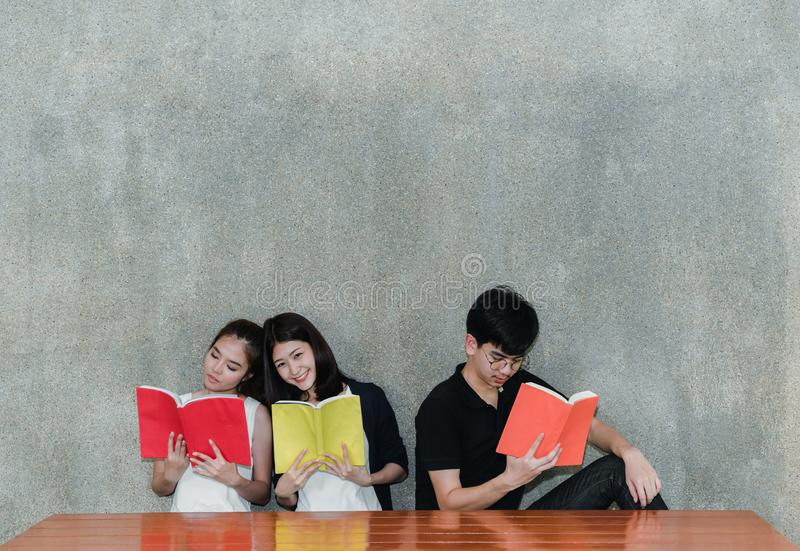 Young Students Group Smiling Reading School Folders Book. On Table and Gray Background in Education Campus University stock images