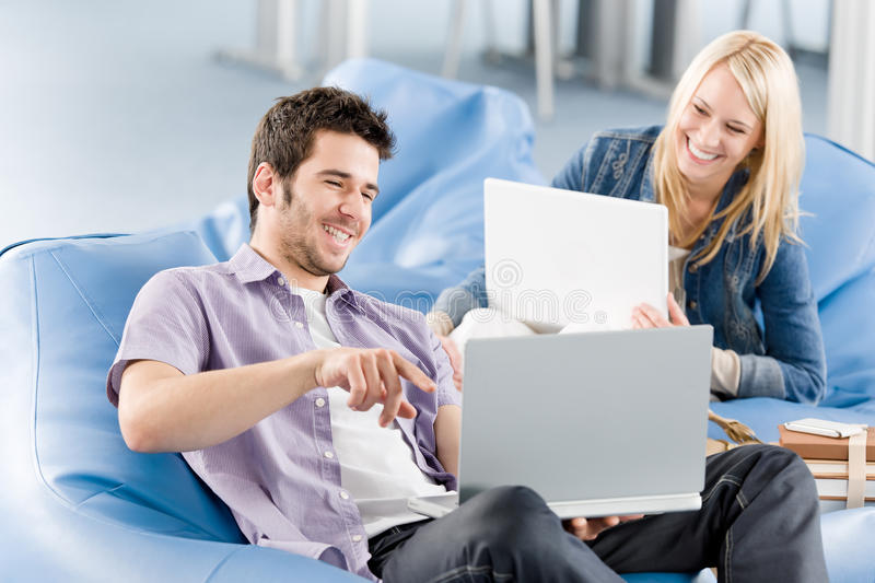 Young students at high-school pointing at laptop stock photos