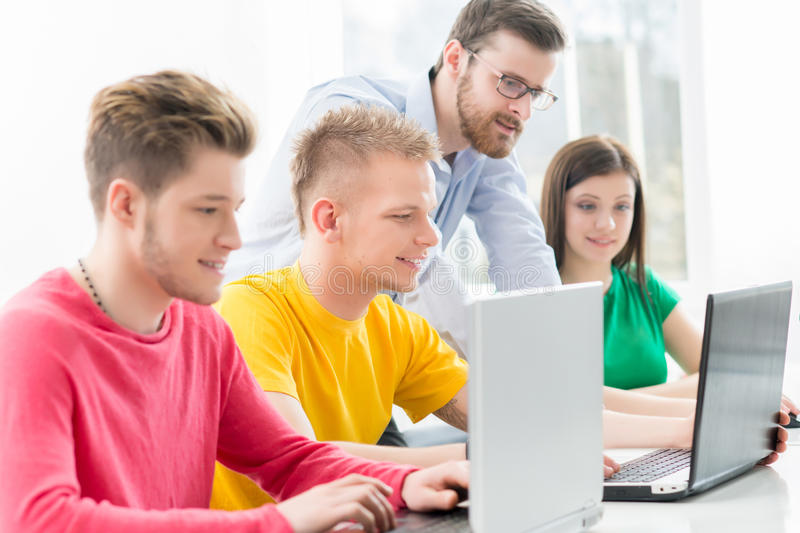Young students studying at the lesson royalty free stock photography