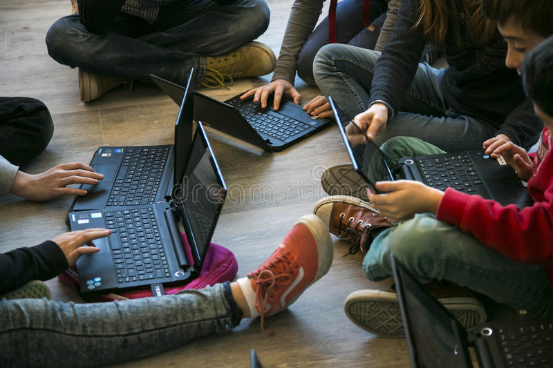 Young Studs. Young students using their laptops during their school daily classes in Mallorca, Spain royalty free stock photos