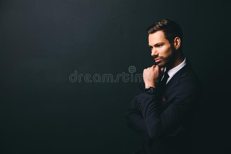 Young stylish businessman holding his chin stock images