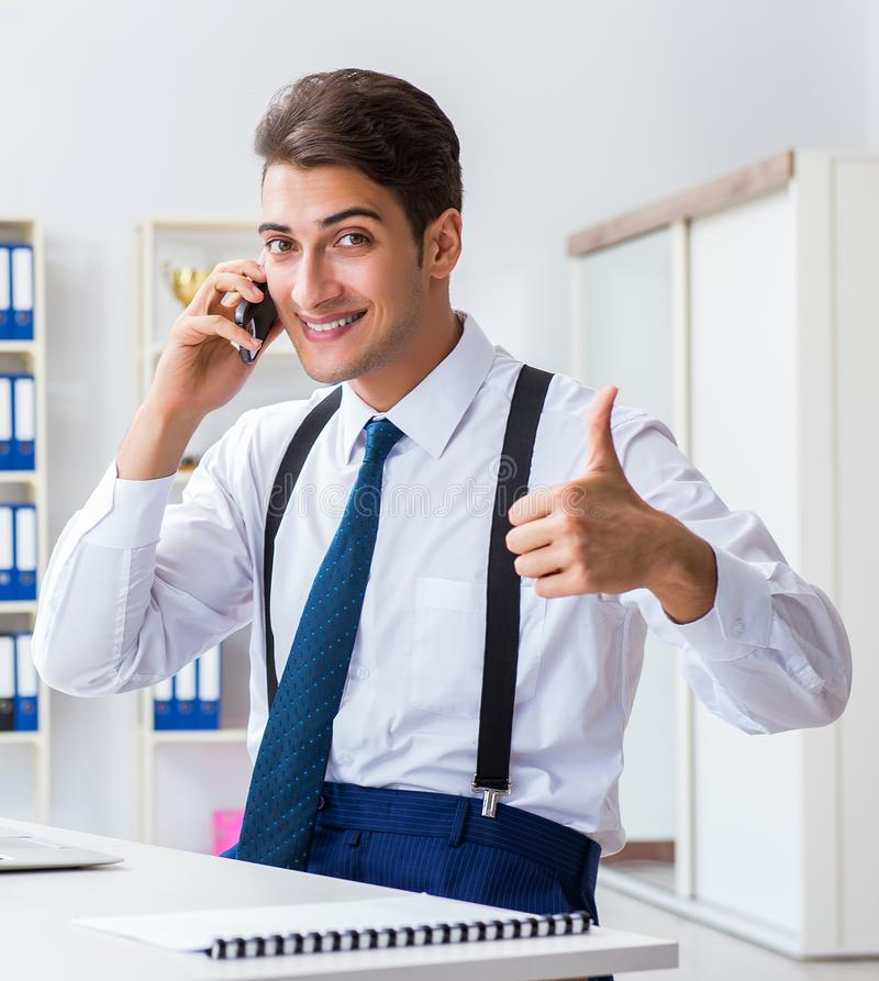 Young stylish businessman working in the office. The young stylish businessman working in the office stock photos