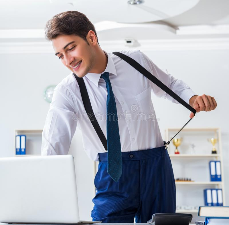 Young stylish businessman working in the office. The young stylish businessman working in the office stock images