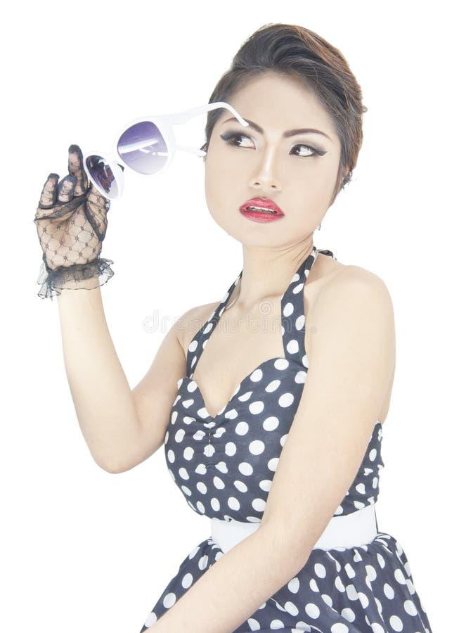 Young stylish caucasian woman posing retro styling. Young stylish caucasian woman posing, isolated over white retro styling royalty free stock image