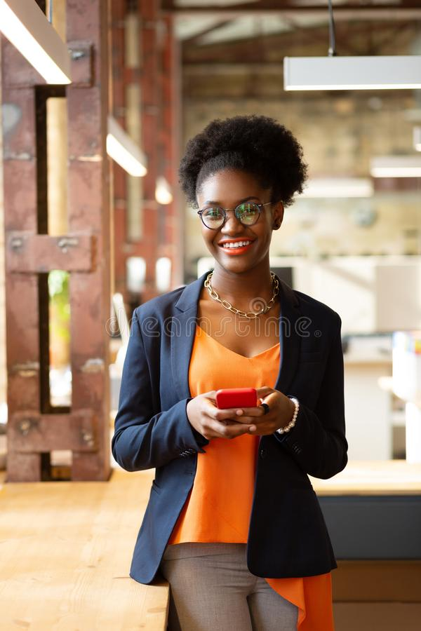 Young stylish curly African-American woman smiling broadly stock images