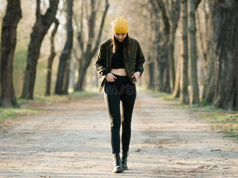 Young stylish girl with belly top walking on an avenue stock photos
