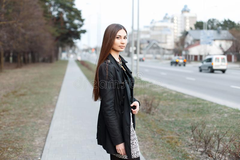 Young stylish girl walking along a path near City stock photos