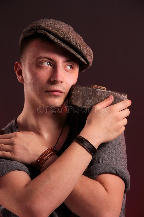 A young stylish guy with a big hammer stock photography
