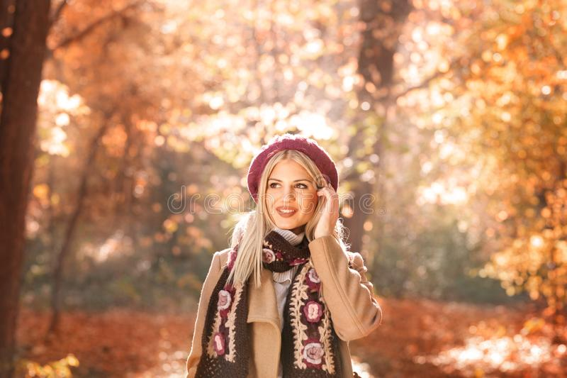 Young stylish lady wearing trendy fall outfit. Outdoor fashion portrait of glamour sensual young stylish lady wearing trendy fall outfit , coat, trendy scarf royalty free stock photography