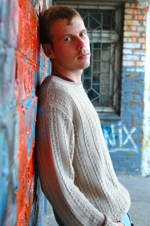 Free Young Stylish Man Stand Near Graffiti Brick Wall. Stock Photography - 6582622
