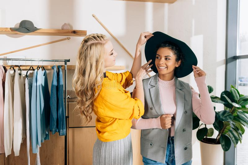 young stylish shopping buddies spending time stock images