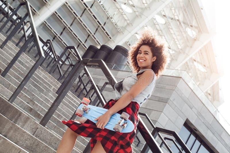 Beautiful Smiling Skater Woman City Skateboarding Stock