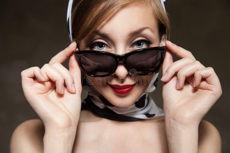 Young stylish woman posing, retro styling royalty free stock photo