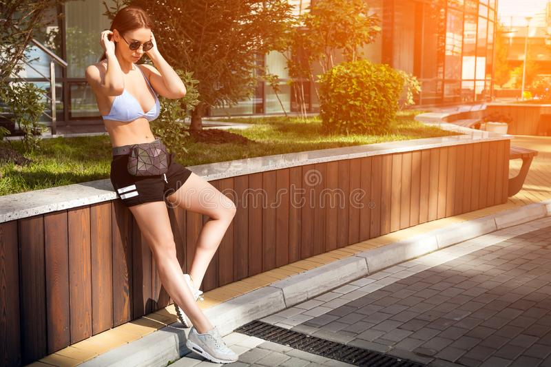 Young stylish woman walking in a city street royalty free stock photos