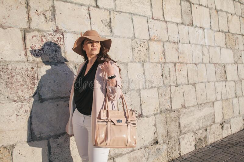 Plus size model wearing fashion clothes in city street stock photo