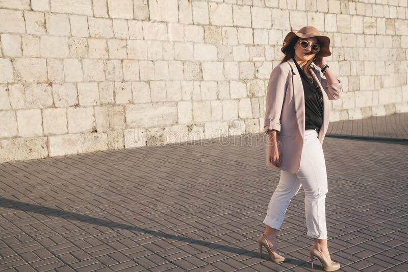 Plus size model wearing fashion clothes in city street royalty free stock photo