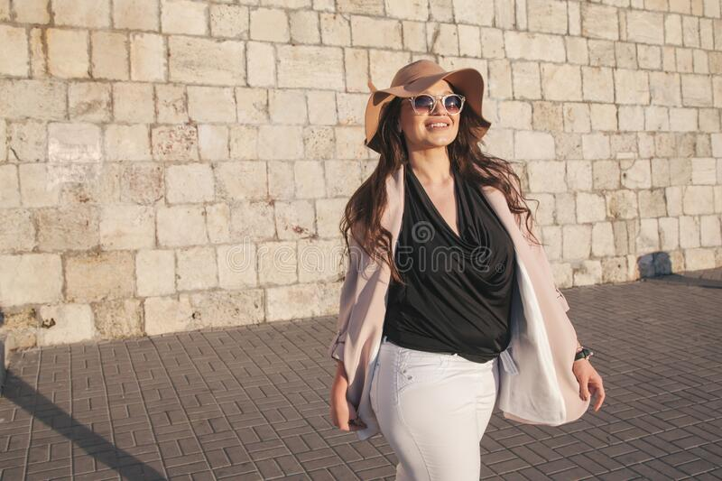 Plus size model wearing fashion clothes in city street royalty free stock image