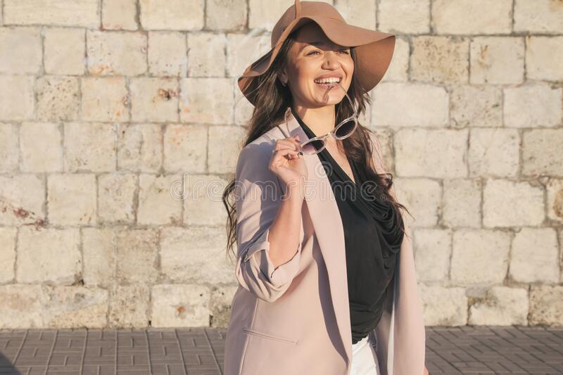 Plus size model wearing fashion clothes in city street stock image