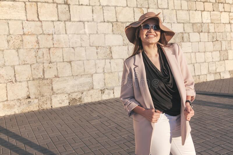 Plus size model wearing fashion clothes in city street stock photos