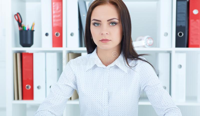 Young successful business woman. Beautiful young businesswoman on office background. royalty free stock photos