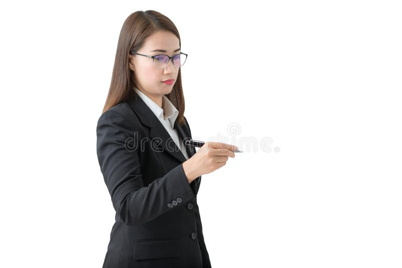 Young successful business woman writing with pen royalty free stock images