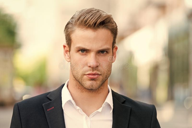 Young and successful. Businessman handsome attractive office worker confident face. Man well groomed elegant formal suit royalty free stock images