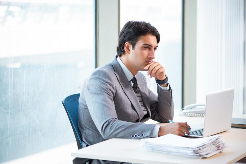 The young successful businessman working at the office stock photography