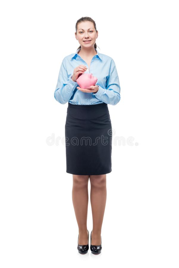Young successful businesswoman with a pink piggy bank on a white stock images